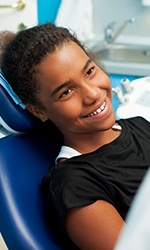 Preteen girl smiling in dental chair
