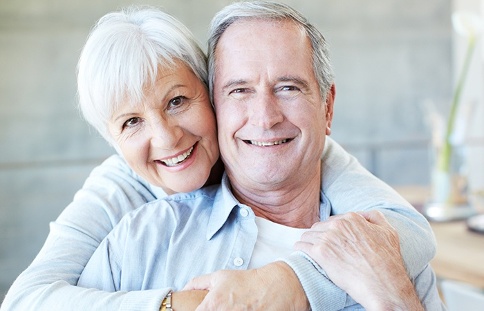Older man and woman smiling
